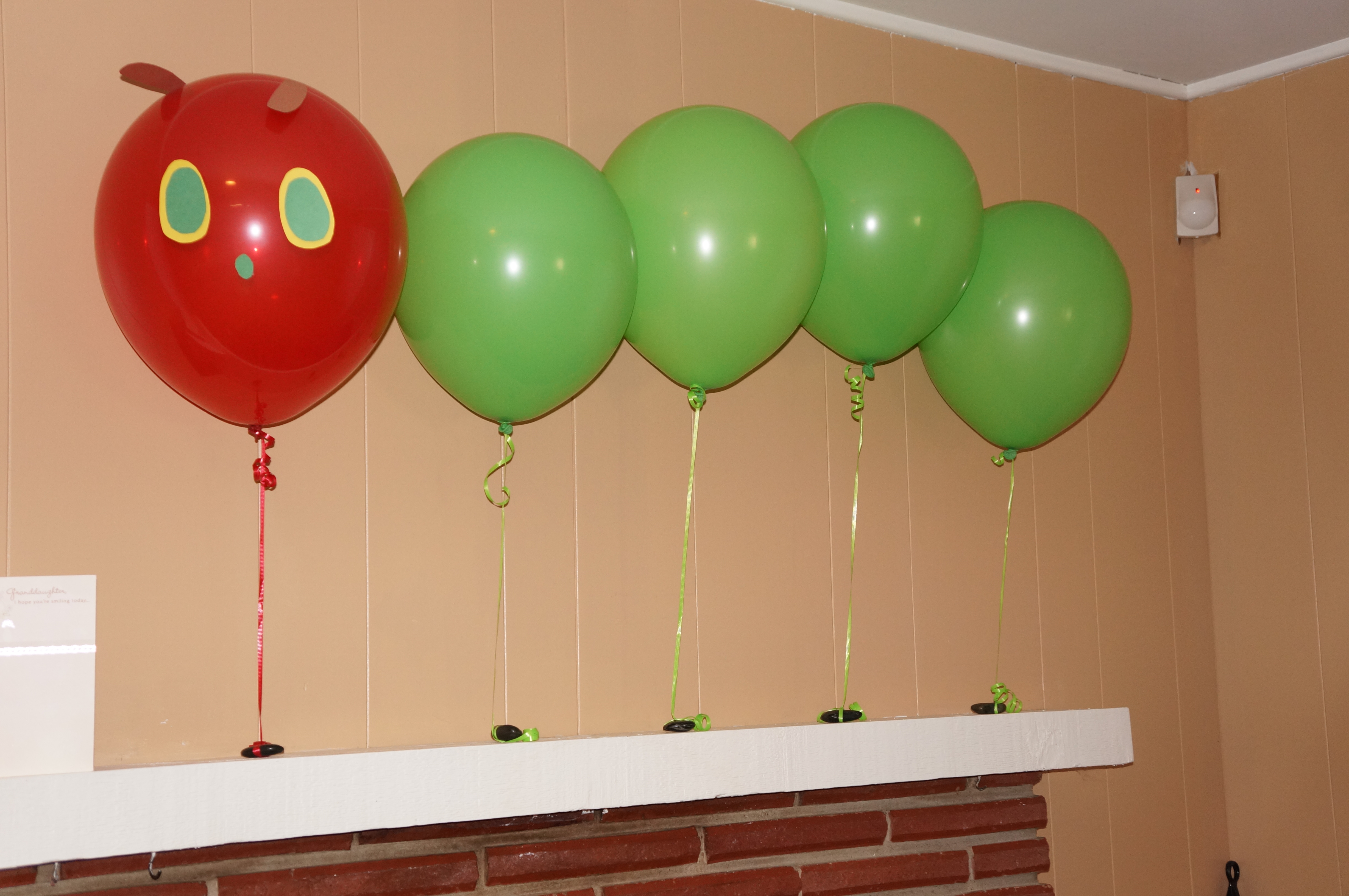 Put some balloons on the mantel to make the Hungry Caterpillar.