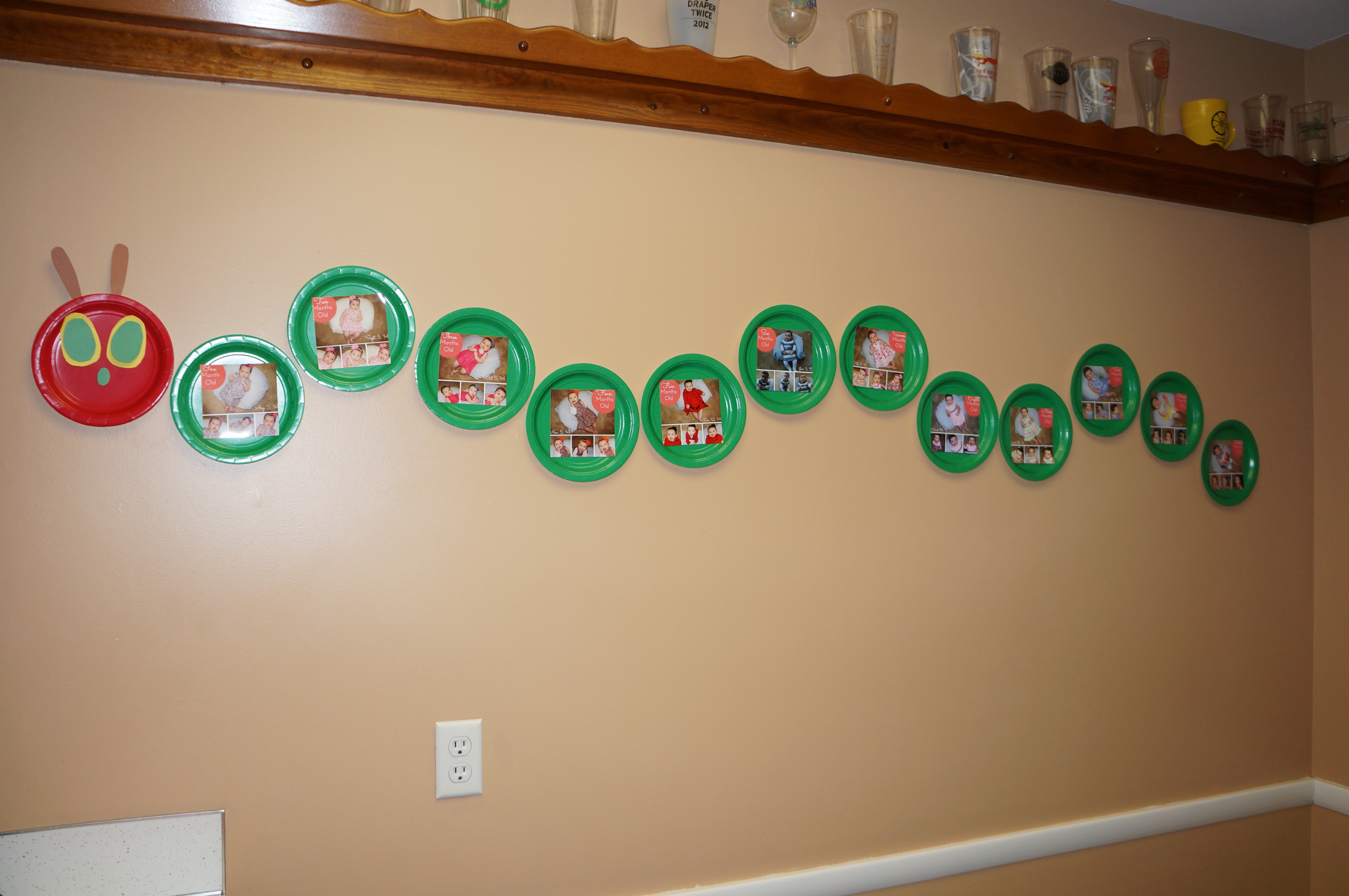 Month by month picture at Hungry Caterpillar 1st birthday