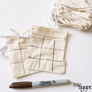 Create a fun tick tac toe travel game with rocks and a cinch pouch in a matter of minutes!